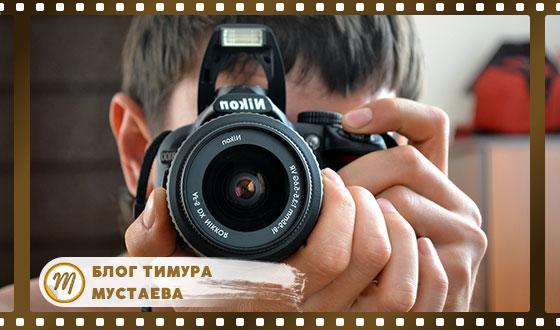 парень с фотоаппаратом