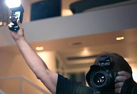фотограф со вспышкой
